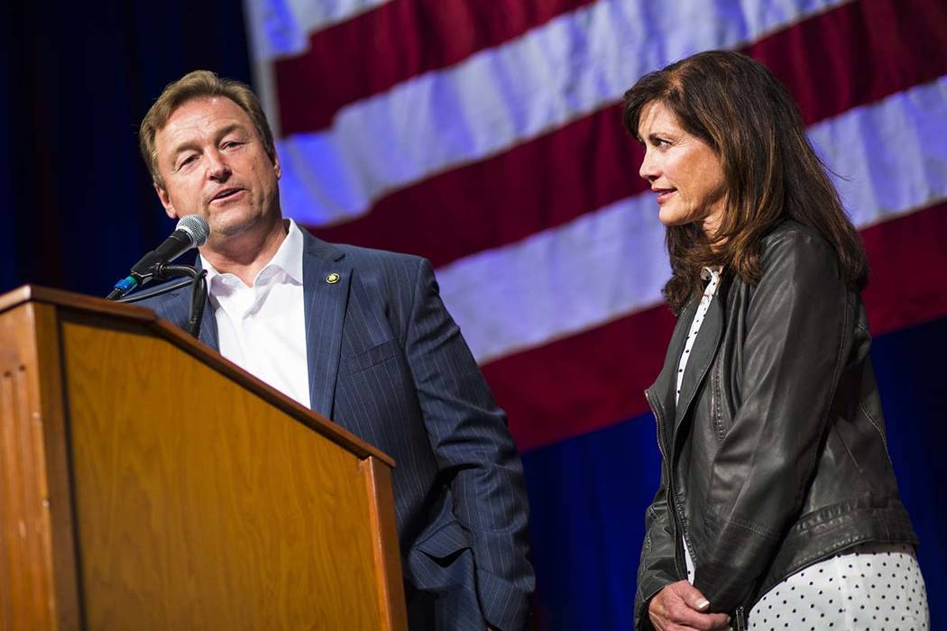 U.S. Sen. Dean Heller, R-Nev., speaks alongside his wife, Lynne, after conceding to challenger U.S. Rep. Jacky Rosen, D-Nev., during the Nevada Republican Party election night watch party at the S ...