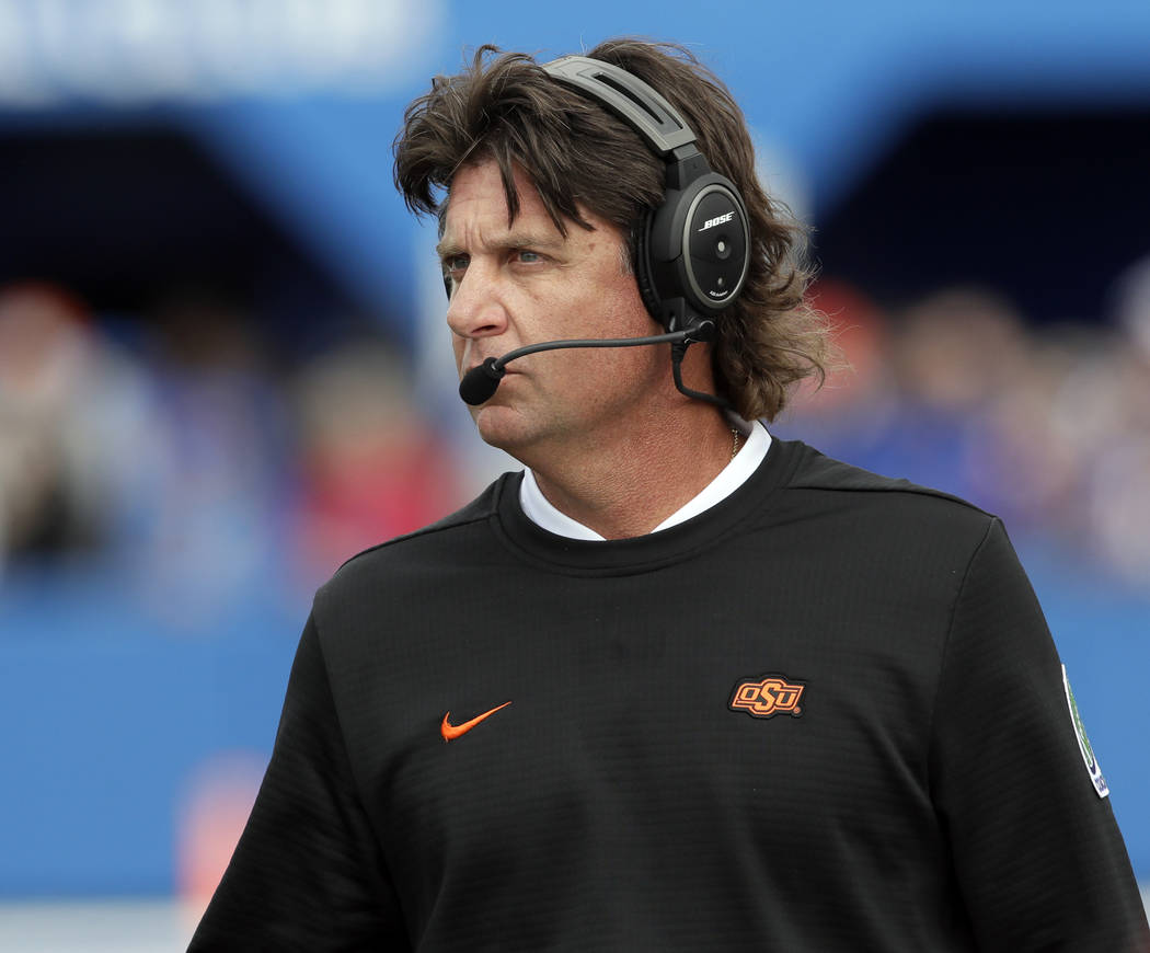 Oklahoma State head coach Mike Gundy watches during the first half of an NCAA college football game against Kansas in Lawrence, Kan., Saturday, Sept. 29, 2018. (AP Photo/Orlin Wagner)