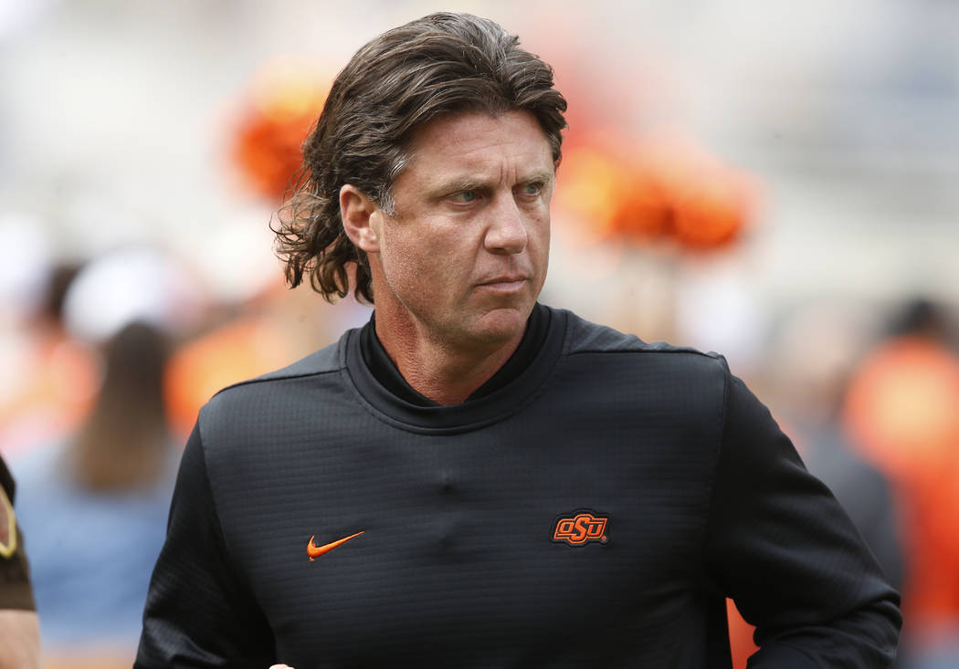 Oklahoma State head coach Mike Gundy runs onto the field before an NCAA college football game between Iowa Stateand Oklahoma State in Stillwater, Okla., Saturday, Oct. 6, 2018. (AP Photo/Sue Ogrocki)