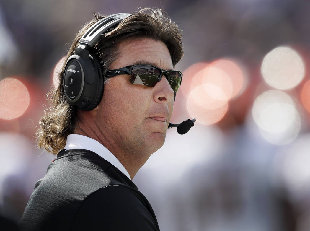 Oklahoma State head coach Mike Gundy keeps a eye on the scoreboard during the first half of an NCAA college football game against Kansas State in Manhattan, Kan., Saturday, Oct. 13, 2018. (AP Phot ...
