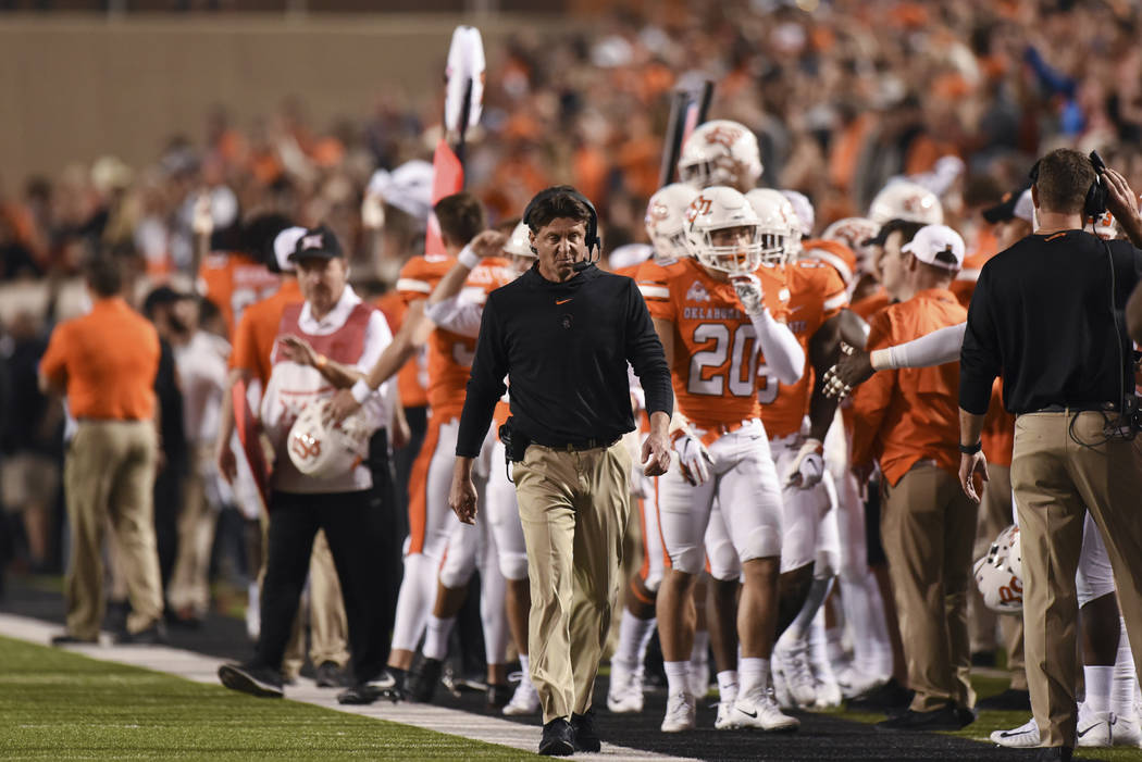Oklahoma State head coach Mike Gundy walks down the sideline during an NCAA college football game in Stillwater, Okla., Saturday, Oct. 27, 2018. (AP Photo/Brody Schmidt)