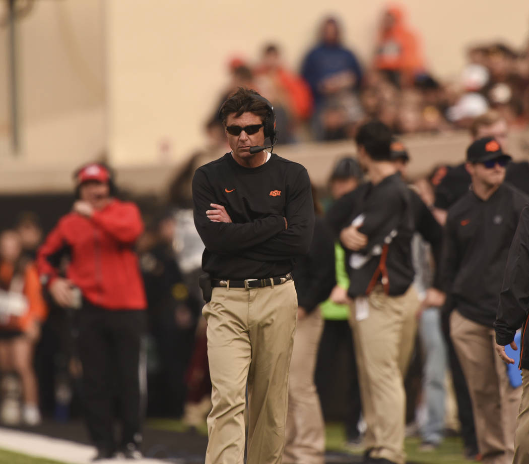 Oklahoma State head coach Mike Gundy walks the sidelines during an NCAA college football game in Stillwater, Okla., Saturday, Nov. 17, 2018. (AP Photo/Brody Schmidt)