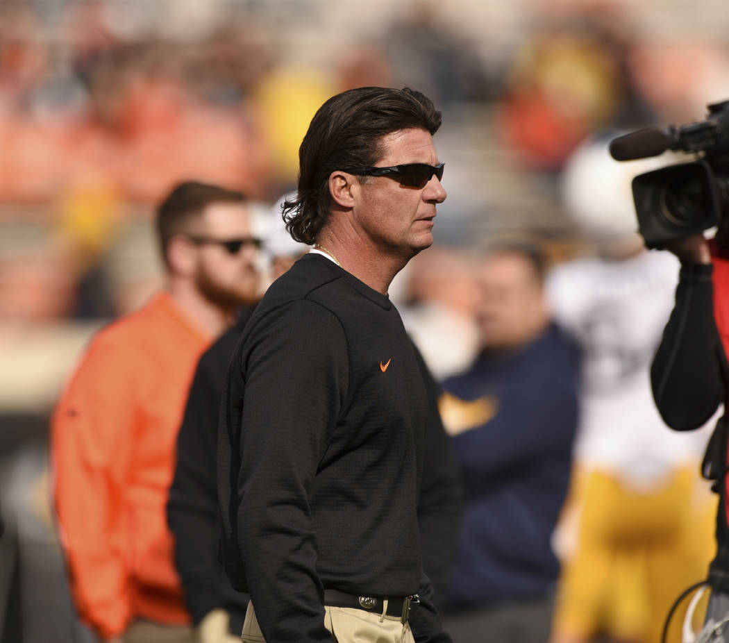 Oklahoma State head coach Mike Gundy walks the sidelines prior to an NCAA college football game in Stillwater, Okla., Saturday, Nov. 17, 2018. (AP Photo/Brody Schmidt)