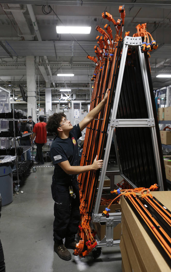 Dustin Mancilla moves drive shafts at the Tesla Gigafactory, east of Reno, Nev., on Tuesday, Dec. 4, 2018. Cathleen Allison Special to Las Vegas Review-Journal