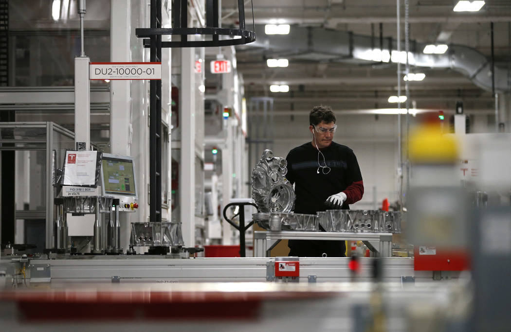 Teakgro Ventra assembles a drive unit at the Tesla Gigafactory, east of Reno, Nev., on Tuesday, Dec. 4, 2018. Cathleen Allison Special to Las Vegas Review-Journal