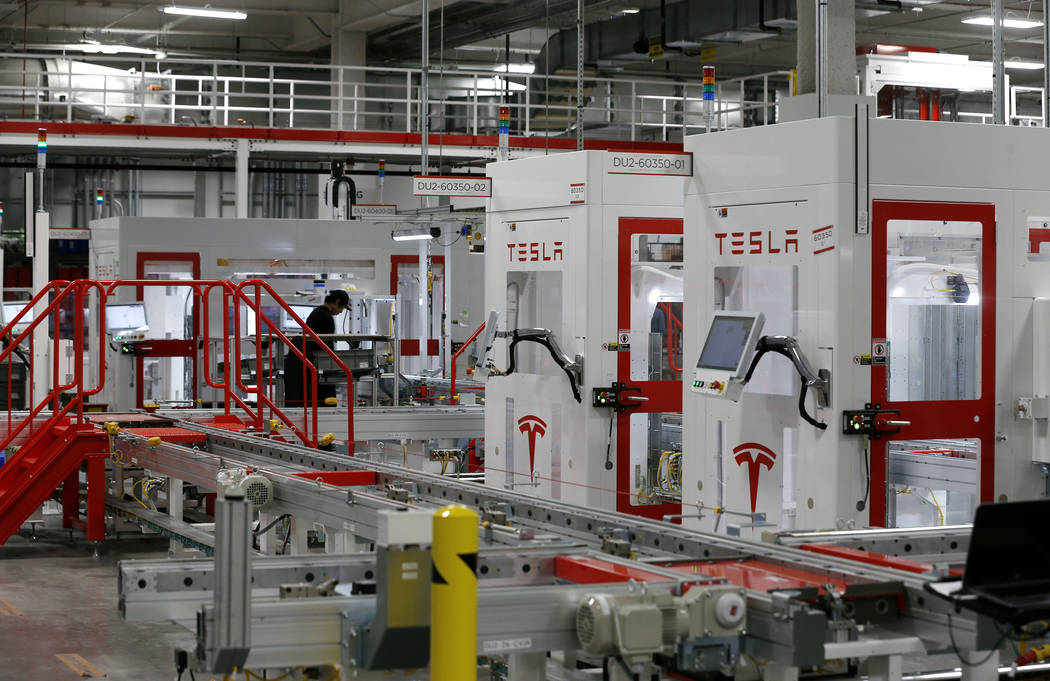 The Tesla Gigafactory, east of Reno, Nev., seen on Tuesday, Dec. 4, 2018, currently sits on a 1.9 million square foot footprint and boosts 5.5 million square feet of total space. Cathleen Allison ...