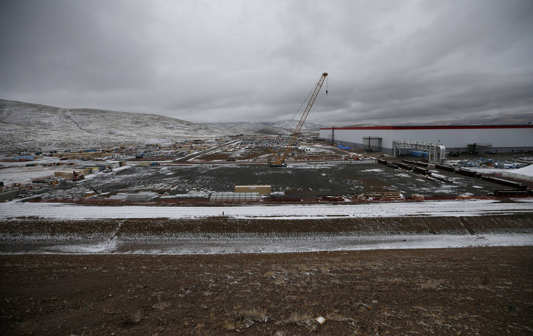 The Tesla Gigafactory, east of Reno, Nev., seen on Tuesday, Dec. 4, 2018, currently sits on a 1.9 million square foot footprint and boosts 5.5 million square feet of total space. (Cathleen Allison ...