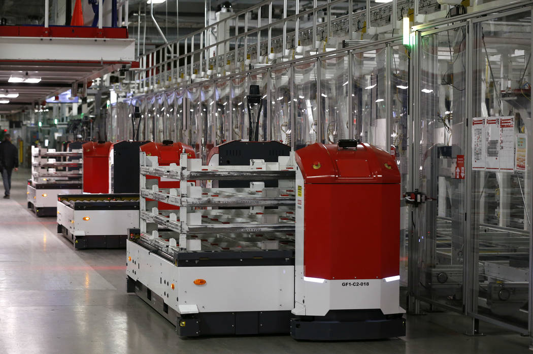 One of many robots works at the Tesla Gigafactory, east of Reno, Nev., on Tuesday, Dec. 4, 2018. Cathleen Allison Special to Las Vegas Review-Journal