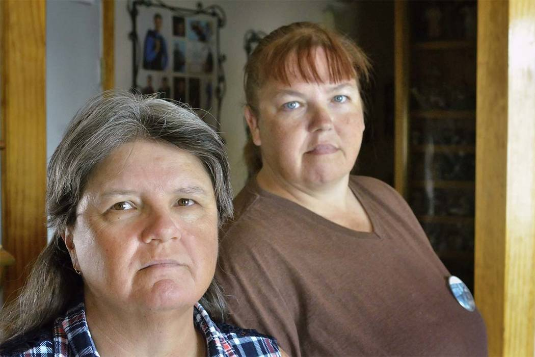 Sisters Sue Ann Cornwell, left, and Billie Jo Lacount, who helped others during the shooting at the Route 91 Harvest festival, at Cornwell's home in Las Vegas on Tuesday, Oct. 31. The siste ...