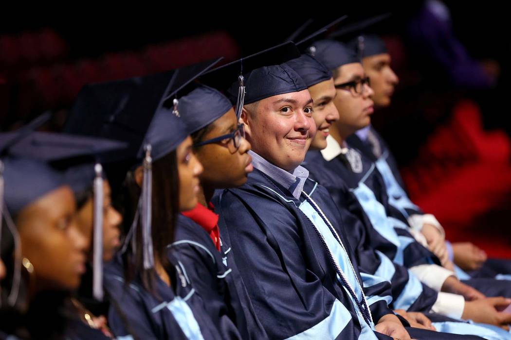 Jaison Arredondo, 18, of Centennial High School, fourth from right, takes part in the Clark County School District summer graduation ceremony on Aug. 7, 2018, at Orleans Arena in Las Vegas. (K.M. ...