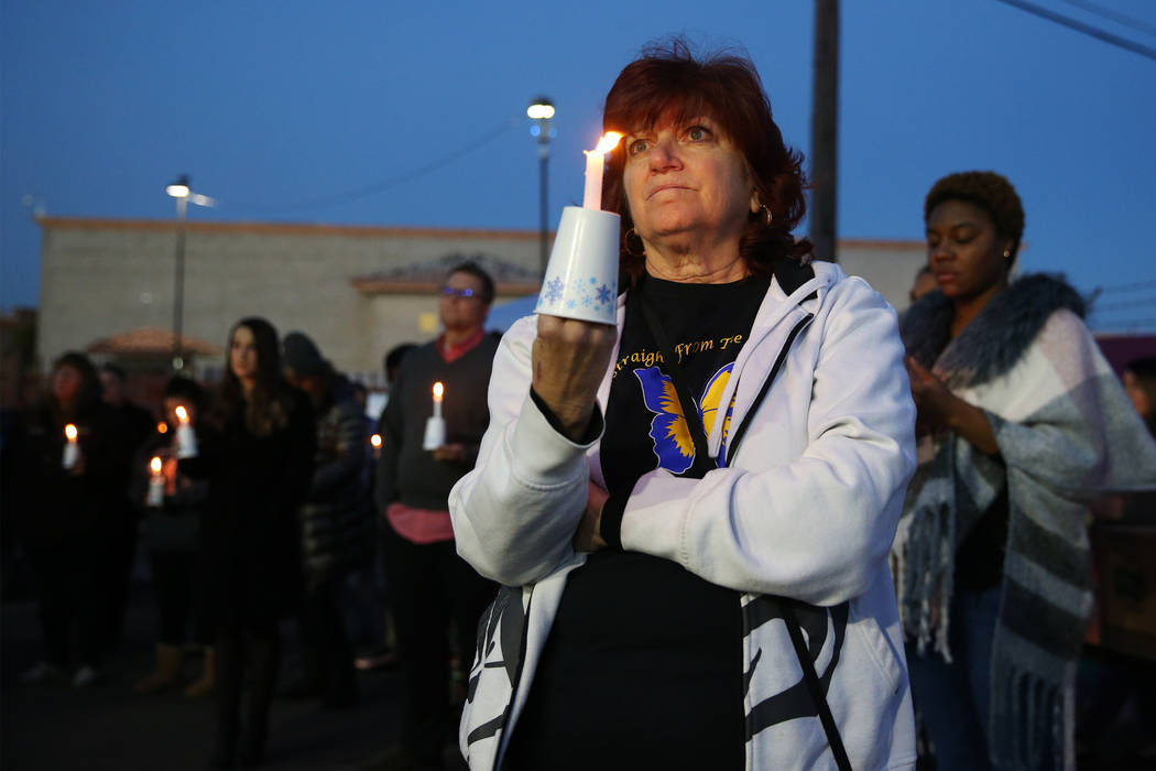 Mary Spriggs, volunteer with Straight From the Streets, holds a candle during the 23rd Annual Homeless Candlelight Vigil at the CARE Complex in Las Vegas, Thursday, Dec. 13, 2018. Erik Verduzco La ...