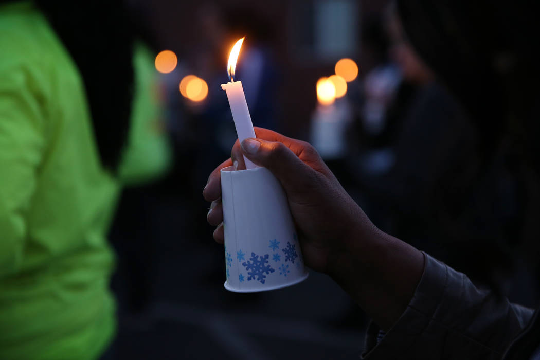 A person holds a candle during the 23rd Annual Homeless Candlelight Vigil at the CARE Complex in Las Vegas, Thursday, Dec. 13, 2018. Erik Verduzco Las Vegas Review-Journal @Erik_Verduzco