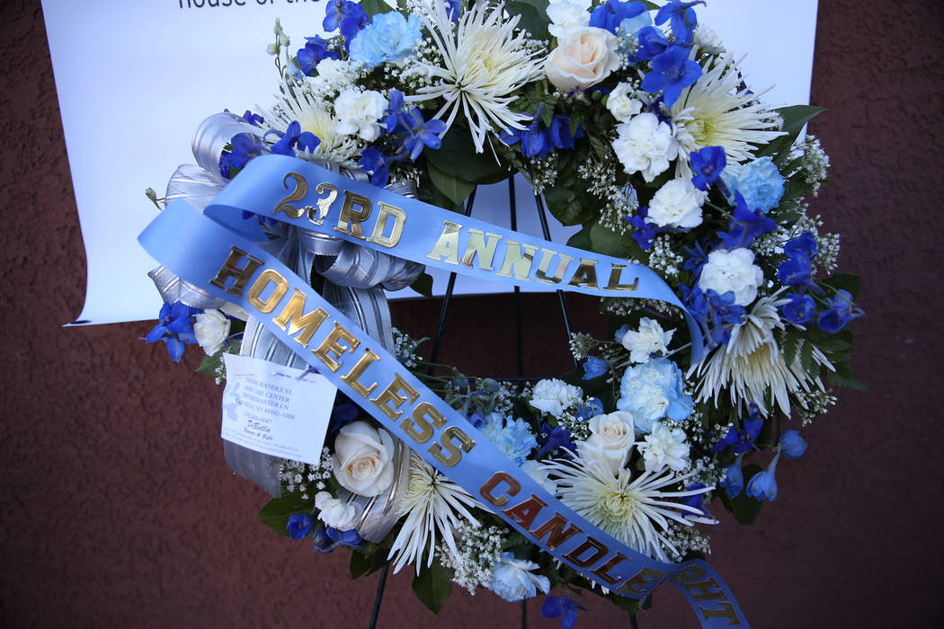 A floral wreath is displayed during the 23rd Annual Homeless Candlelight Vigil at the CARE Complex in Las Vegas, Thursday, Dec. 13, 2018. Erik Verduzco Las Vegas Review-Journal @Erik_Verduzco