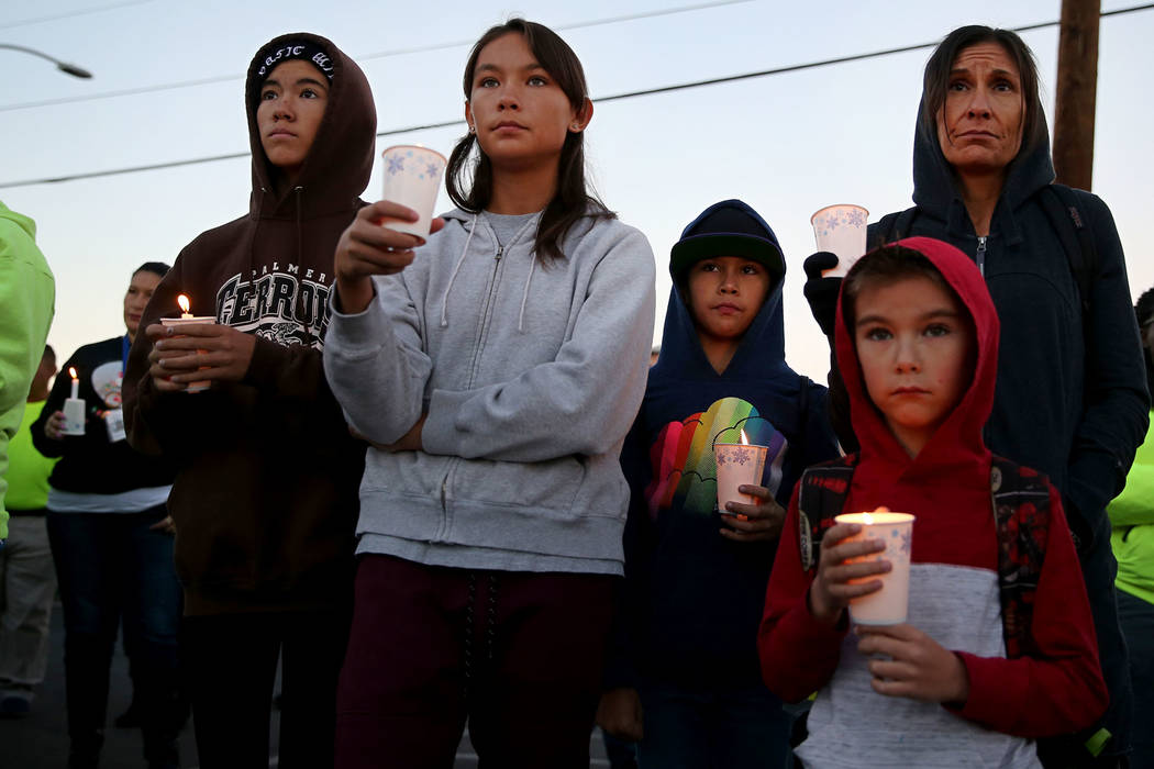 Jennie Rico of Las Vegas, far right, with her children from left, Nia, 14, Lola, 12, Trinity, 10, and Benjamin, 7, attend the 23rd Annual Homeless Candlelight Vigil at the CARE Complex in Las Vega ...