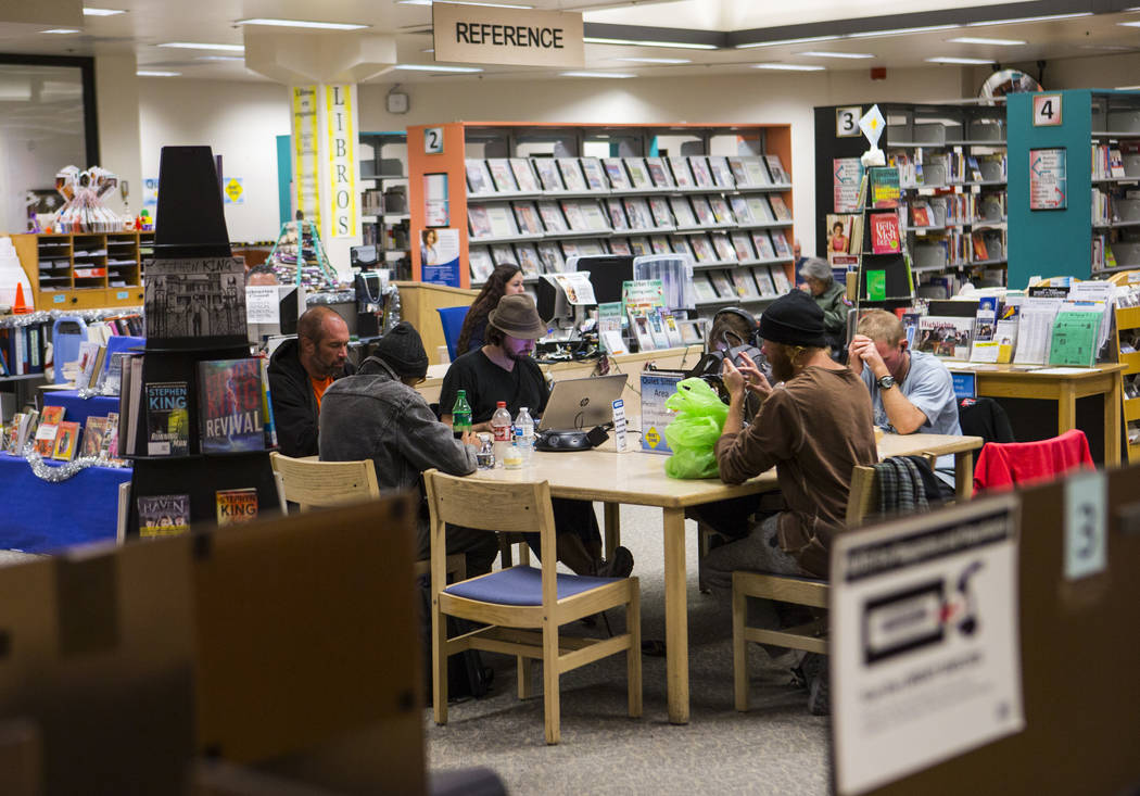 People use laptops, phones and other devices in a quiet sitting area at West Las Vegas Library in Las Vegas on Thursday, Dec. 13, 2018. Chase Stevens Las Vegas Review-Journal @csstevensphoto