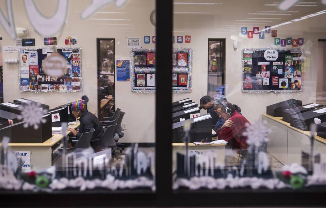People use computers at West Las Vegas Library in Las Vegas on Thursday, Dec. 13, 2018. Chase Stevens Las Vegas Review-Journal @csstevensphoto