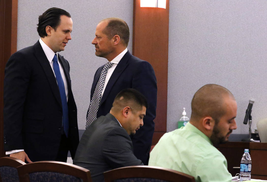 Defense attorneys Kyle Cottner, left, and Ross Goodman, representing ex-Nevada Department of Corrections officers Paul Valdez, center, and Jose Navarrete, in court at the Regional Justice Center o ...