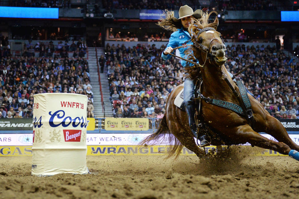 Brittany Pozzi of Tonozzi of Victoria, Texas (11) competes in Barrel Racing during the sixth go-round of the National Finals Rodeo at the Thomas & Mack Center in Las Vegas, Tuesday, Dec. 11, 2 ...