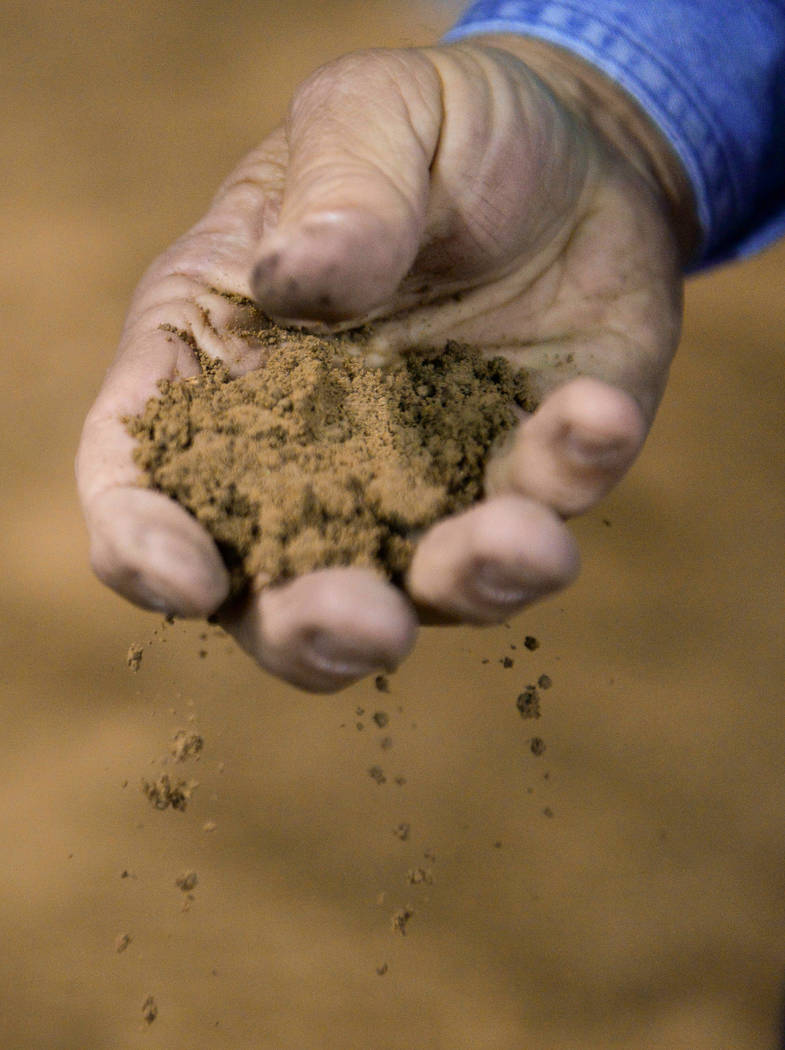 Ground Manager John Jamison holds a handful of dirt from the arena area at the National Finals Rodeo at Thomas & Mack Center in Las Vegas, Tuesday, Dec. 11, 2018. Caroline Brehman/Las Vegas Re ...