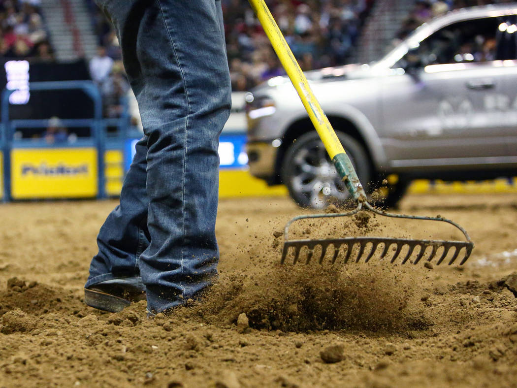 Maintenance workers rake up the dirt in the arena between events during sixth go-round of the National Finals Rodeo at Thomas & Mack Center in Las Vegas, Tuesday, Dec. 11, 2018. Caroline Brehm ...
