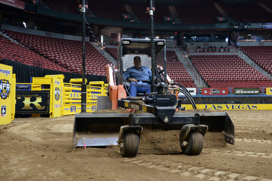 Construction Maintenance Manager Allen Rheinheimer levels out the dirt in the arena in preparation for the sixth go-round of the National Finals Rodeo at Thomas & Mack Center in Las ...