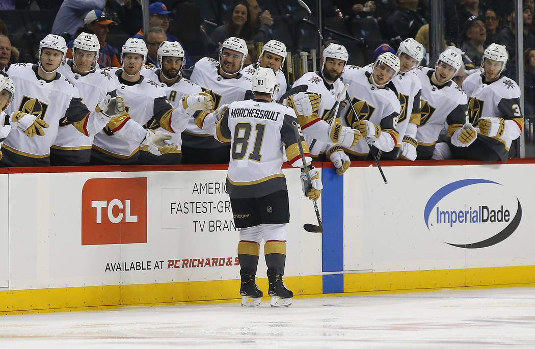 Vegas Golden Knights center Jonathan Marchessault (81) celebrates with teammates after scoring a goal against the New York Islanders during the first period of an NHL hockey game, Wednesday, Dec.1 ...