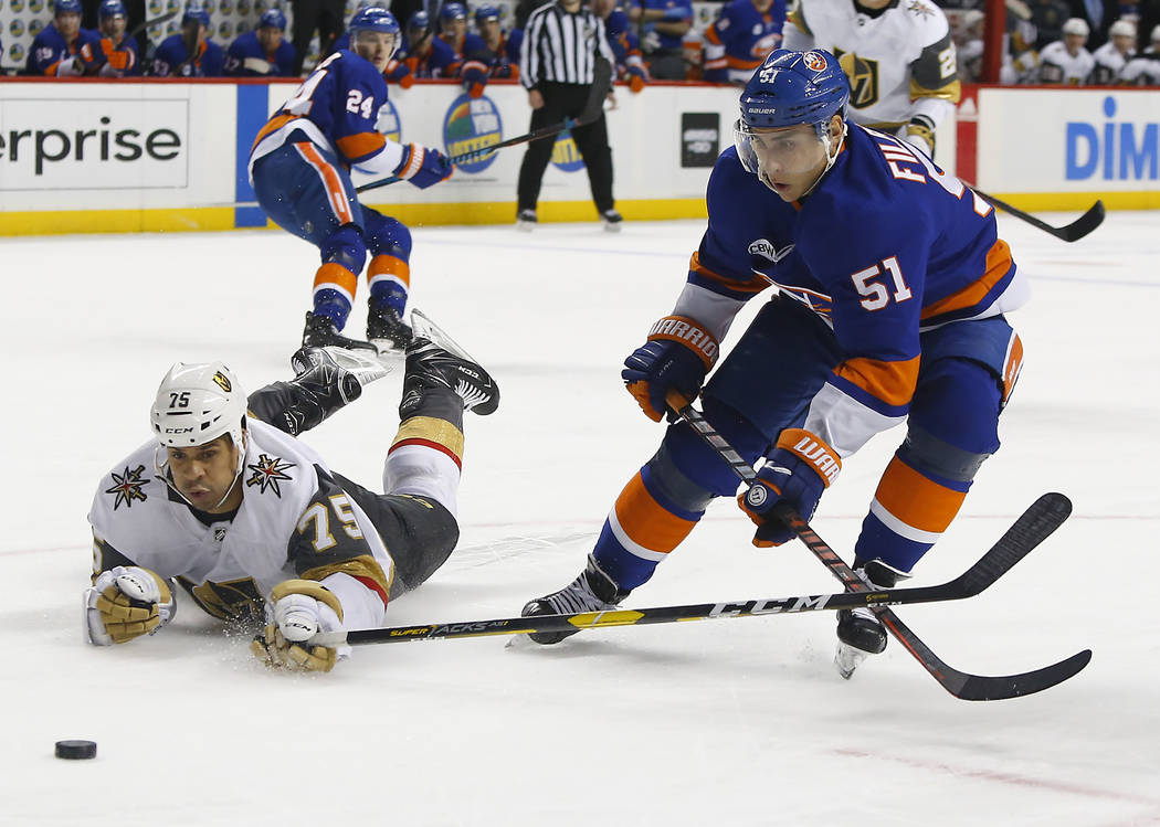 New York Islanders center Valtteri Filppula (51) plays the puck against Vegas Golden Knights right wing Ryan Reaves (75) during the second period of an NHL hockey game, Wednesday, Dec.12, 2018, in ...