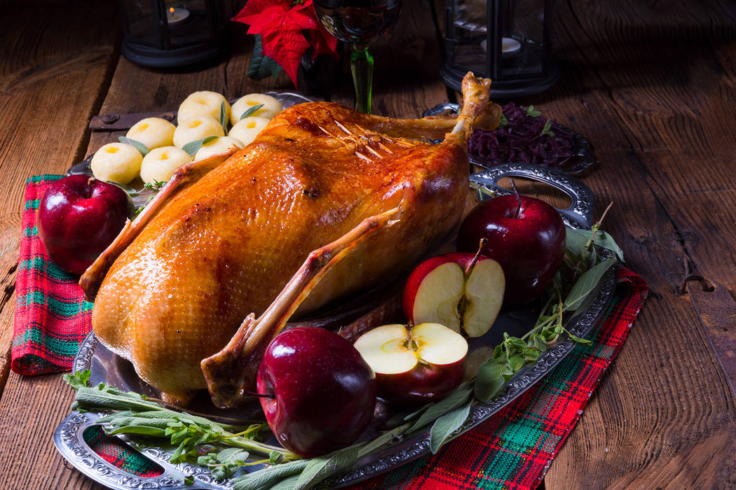 Stuffed roast goose with red cabbage and dumplings (Getty Images)