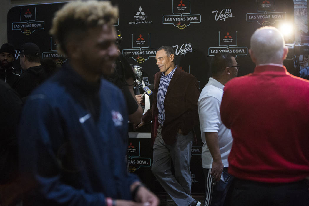 Arizona State head coach Herm Edwards, middle, talks to the media on Monday, Dec. 11, 2018, at Maverick Helicopters, in Las Vegas. Benjamin Hager Las Vegas Review-Journal