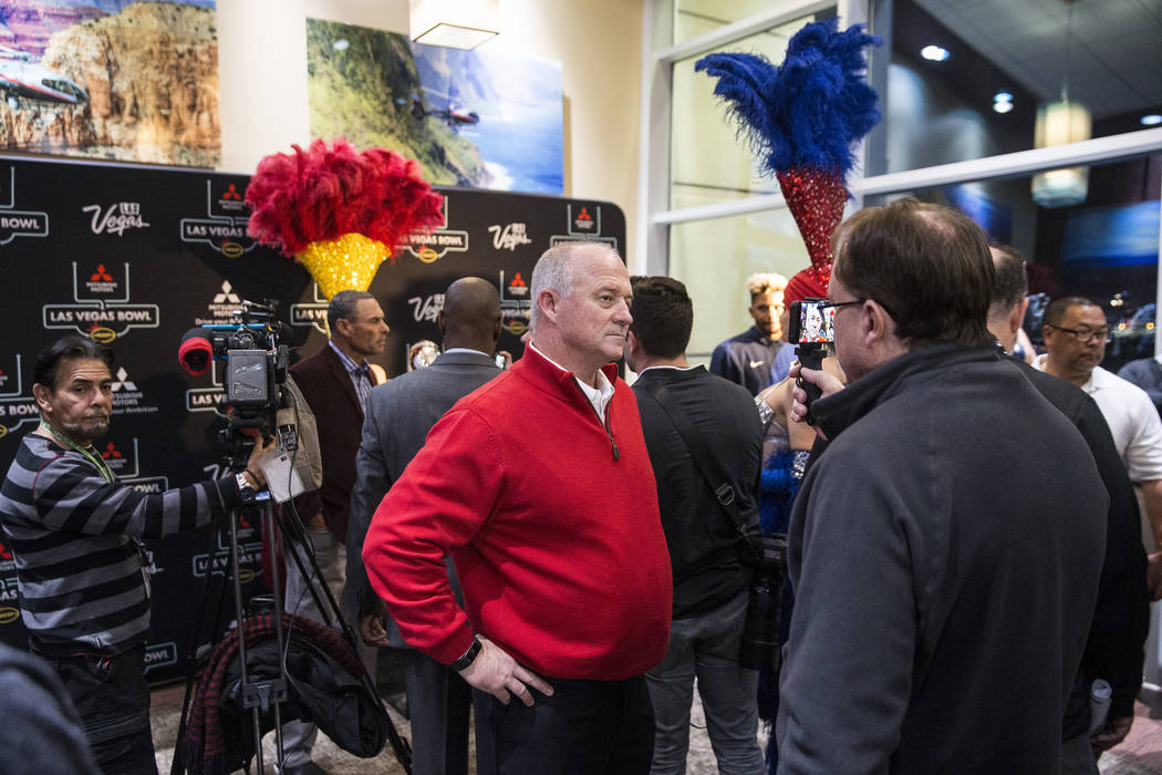 Fresno State head coach Jeff Tedford, middle, talks to the media on Monday, Dec. 11, 2018, at Maverick Helicopters, in Las Vegas. Benjamin Hager Las Vegas Review-Journal