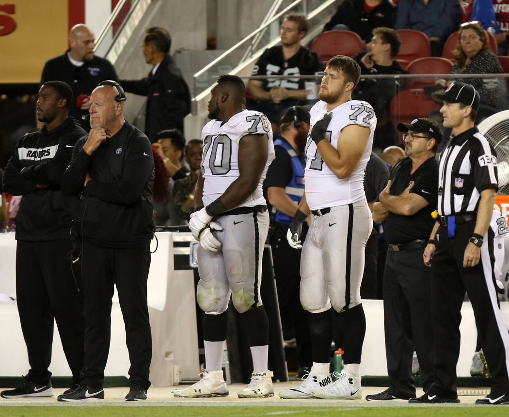Oakland Raiders offensive guard Kelechi Osemele (70) and Oakland Raiders offensive tackle Kolton Miller (77) on the sideline during the second half of their NFL game against the San Francisco 49er ...