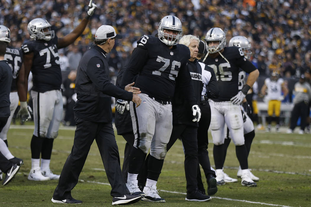 Oakland Raiders offensive guard Jon Feliciano (76) is helped off the field during the second half of an NFL football game against the Pittsburgh Steelers in Oakland, Calif., Sunday, Dec. 9, 2018. ...