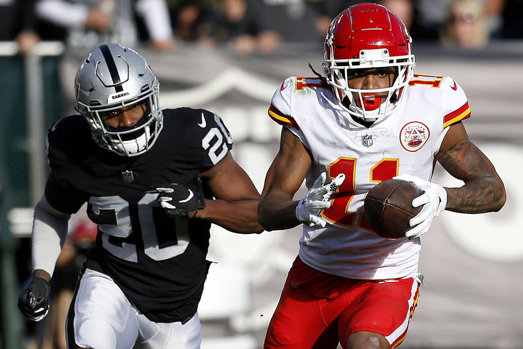 Kansas City Chiefs wide receiver Demarcus Robinson (11) runs in front of Oakland Raiders cornerback Daryl Worley (20) during the first half of an NFL football game in Oakland, Calif., Sunday, Dec. ...