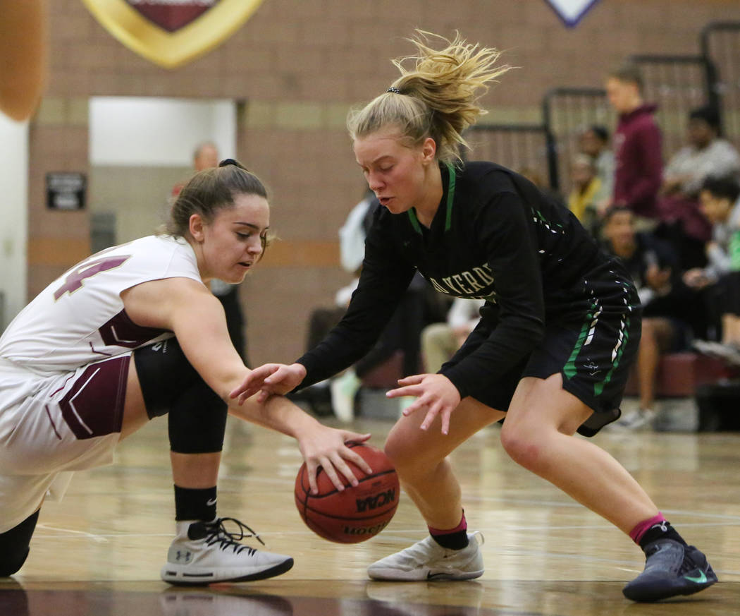 Faith Lutheran's Kelsey Howryla (34) and Palo Verde's Ashley Marushok (25) reach for the ball at Faith Lutheran High School in Las Vegas, Thursday, Dec. 13, 2018. Caroline Brehman/Las Vegas Revie ...