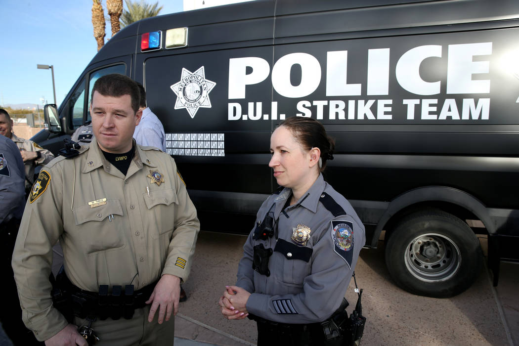 Nevada Highway Patrol Trooper Deborah Huff and Metropolitan Police Department Traffic Officer Mike Thiele after a Office of Traffic Safety news conference on the joint Metro-NHP DUI Strike Team in ...