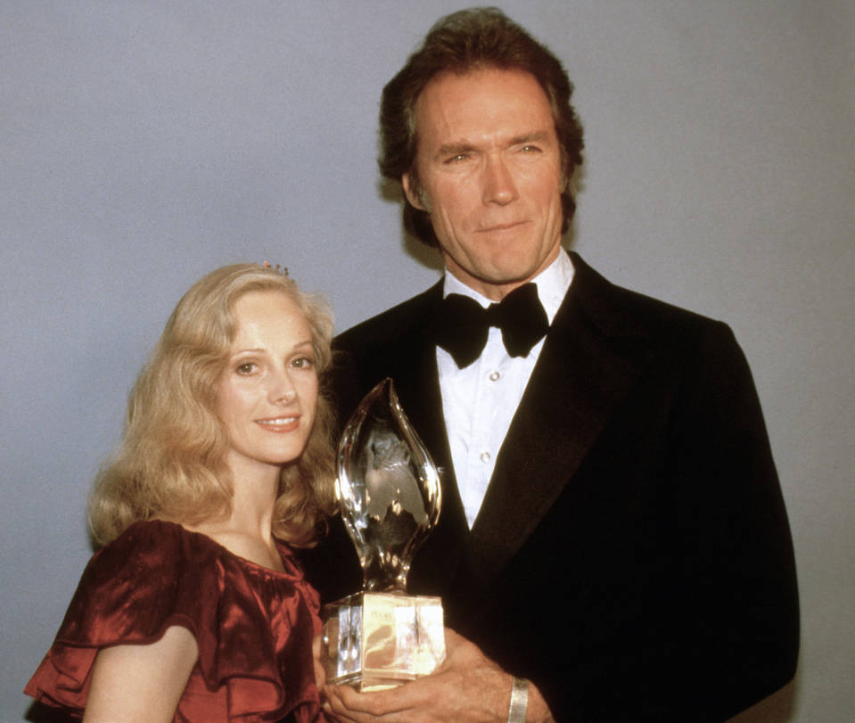 In this March 5, 1981 file photo, Clint Eastwood poses with his girlfriend Sondra Locke, left, and his People's Choice Award for favorite motion picture actor in Los Angeles. (AP Photo, File)