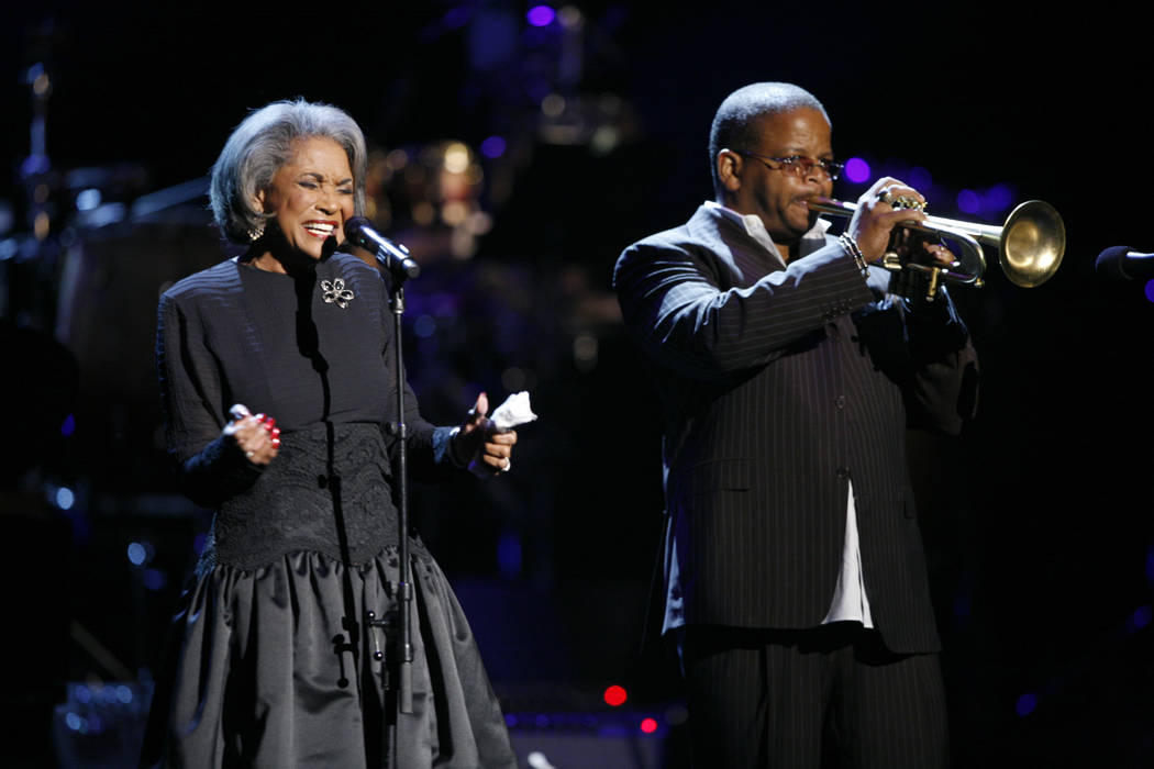 In this Oct. 28, 2007 file photo, Nancy Wilson, left, and Terence Blanchard, right, perform during an all-star tribute concert for Herbie Hancock, in Los Angeles. Grammy-winning jazz and pop singe ...