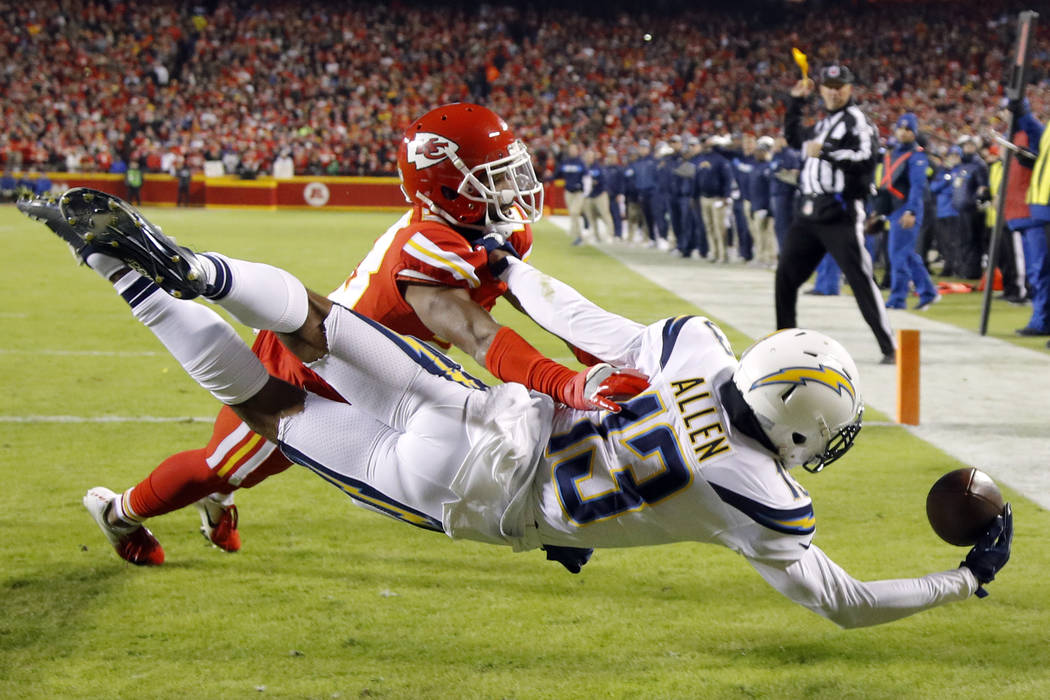 Los Angeles Chargers wide receiver Keenan Allen (13) attempts a touchdown against Kansas City Chiefs defensive back Eric Berry during the first half of an NFL football game in Kansas City, Mo., Th ...