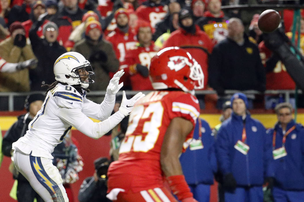 Kansas City Chiefs cornerback Kendall Fuller (23) watches as Los Angeles Chargers wide receiver Mike Williams (81) makes a two-point conversion catch to win the game during the second half of an N ...