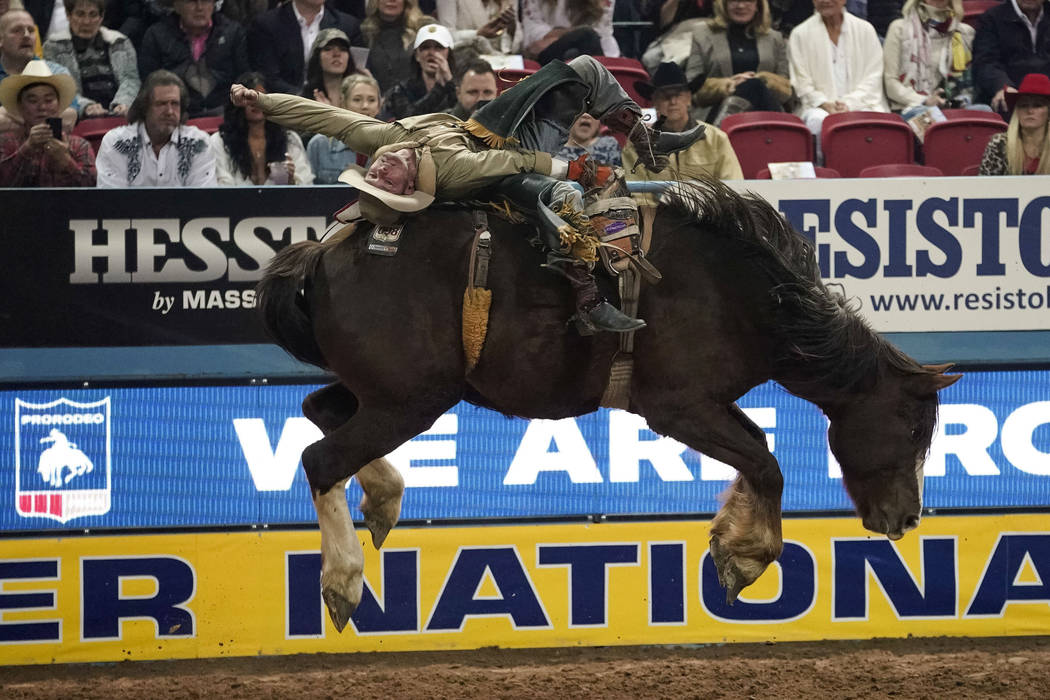 Will Lowe of Canyon, Texas (120) competes in the bareback riding event during the eighth go-round of the National Finals Rodeo at the Thomas & Mack Center in Las Vegas on Thursday, Dec. 13, 20 ...
