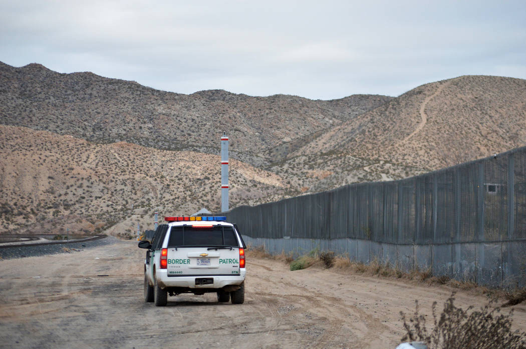 In this Jan. 4, 2016, file photo, a U.S. Border Patrol agent patrols Sunland Park along the U.S.-Mexico border next to Ciudad Juarez. A 7-year-old girl who had crossed the U.S.-Mexico border with ...