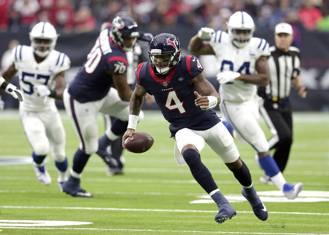Houston Texans quarterback Deshaun Watson (4) rushes for a gain against the Indianapolis Colts during the first half of an NFL football game Sunday, Dec. 9, 2018, in Houston. (AP Photo/Michael Wyke)