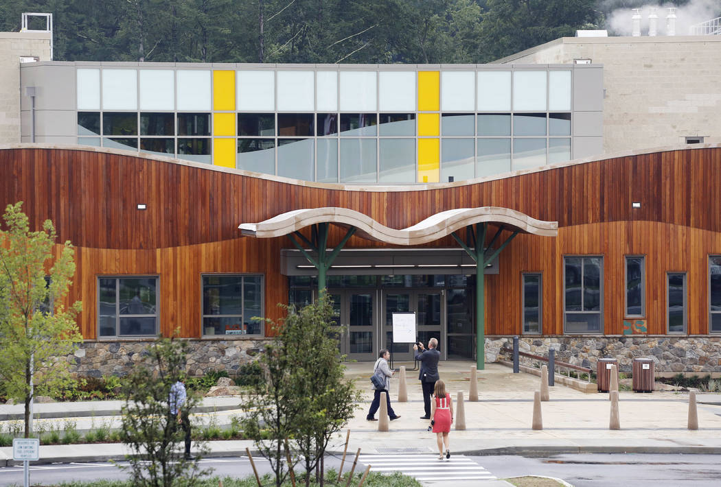 People attend an open house at the new Sandy Hook Elementary School in Newtown, Conn. on July 29, 2016, built to replace the one that was demolished where 20 first graders and six educators were s ...