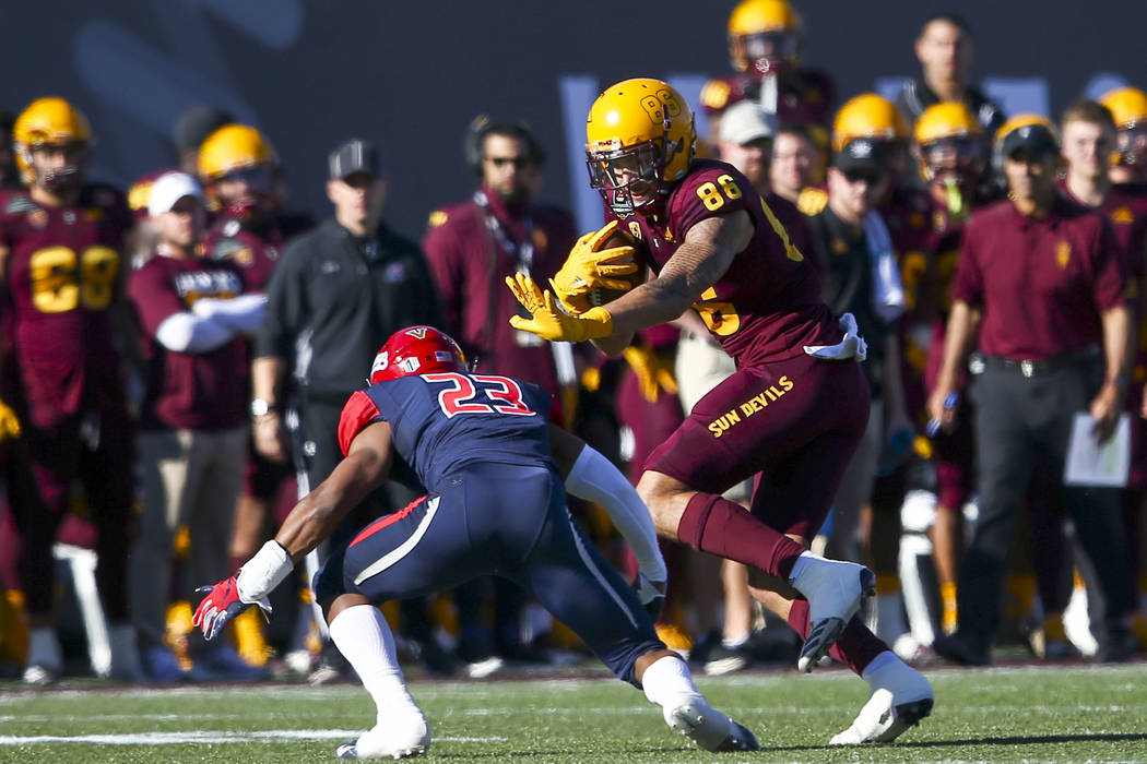 Arizona State wide receiver Curtis Hodges (86) runs the ball against Fresno State defensive back Juju Hughes (23) during the first half of the Las Vegas Bowl football game at Sam Boyd Stadium in L ...