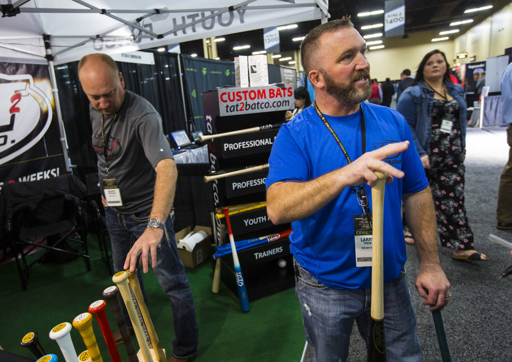 Larry Thein of the Tat2 Bat Company talks about fungo bats during the baseball trade show at Major League Baseball's winter meetings at Mandalay Bay in Las Vegas on Tuesday, Dec. 11, 2018. Chase S ...