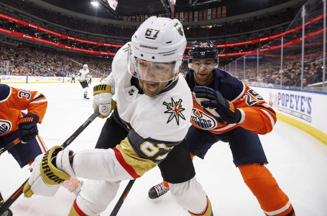 Vegas Golden Knights' Max Pacioretty (67) and Edmonton Oilers' Darnell Nurse (25) battle in the corner during the second period of an NHL hockey game Saturday, Dec. 1, 2018, in Edmonton, Alberta. ...