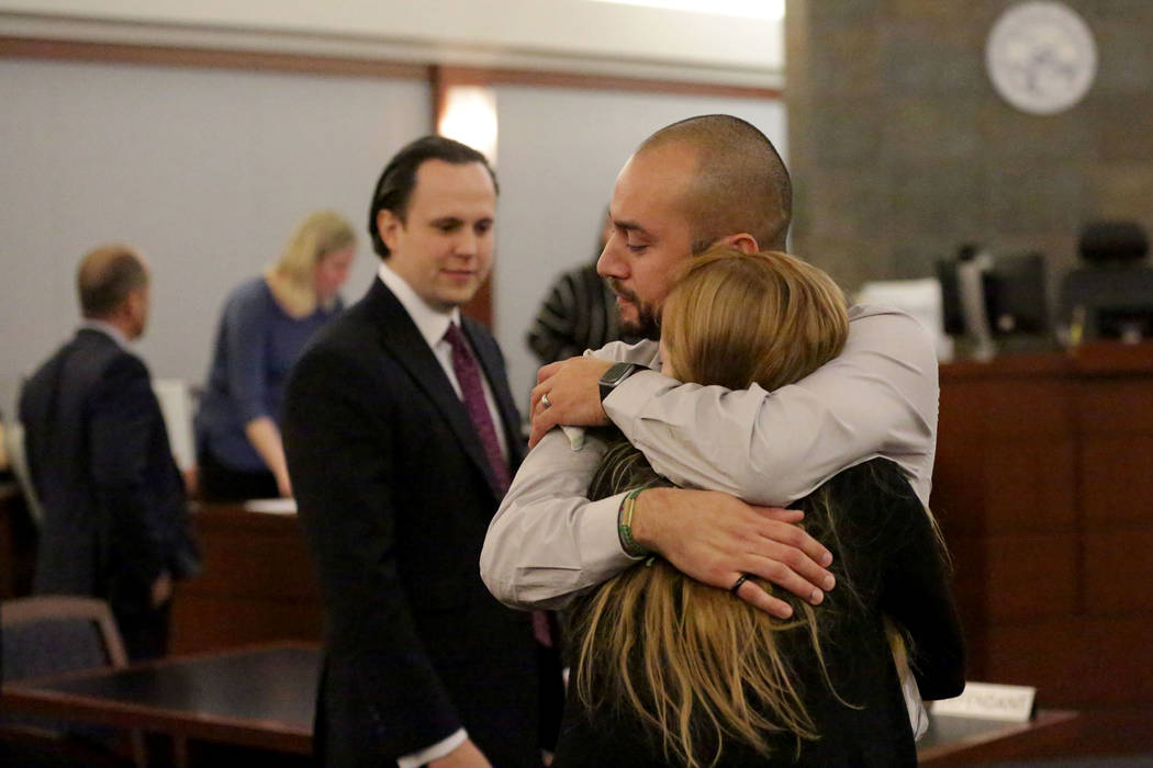 Jose Navarrete, one of two former Nevada Department of Corrections officers accused of using unnecessary force on an inmate, embraces his wife Holly after being found not guilty on all counts on F ...