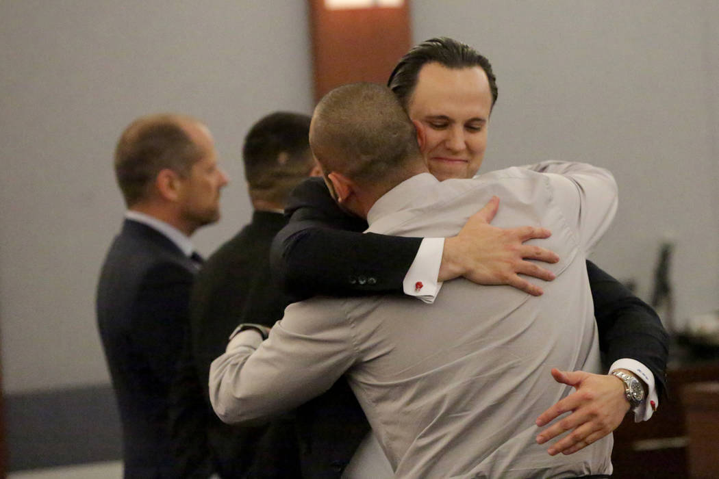 Defense attorney Kyle Cottner embraces his client Jose Navarrete, one of two former Nevada Department of Corrections officers accused of using unnecessary force on an inmate, after a jury returns ...