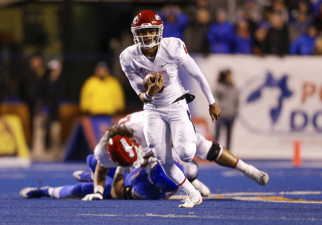 Fresno State quarterback Marcus McMaryion (6) runs with the ball against Boise State in the first half of an NCAA college football game, Friday, Nov. 9, 2018, in Boise, Idaho. Boise State won 24-1 ...