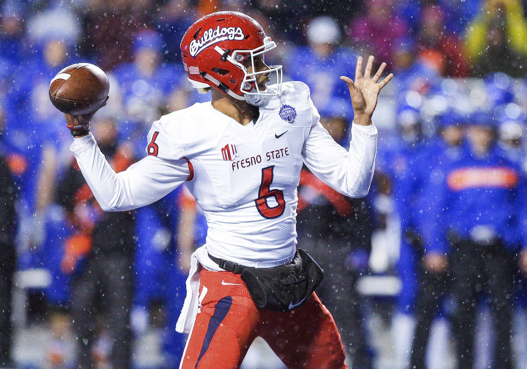 Fresno State quarterback Marcus McMaryion (6) throws a touchdown pass against Boise State during the first half of an NCAA college football game for the Mountain West championship, Saturday, Dec. ...